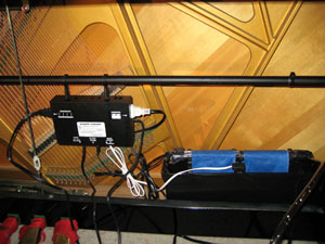 Piano Life saver system in a vertical piano