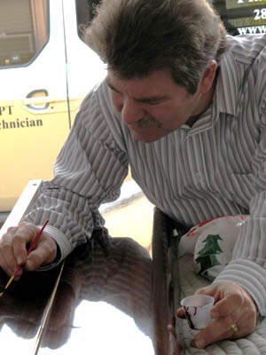 Mike Ello, RPT performing a lacquer touch up